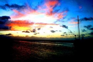 Beautiful Sunset over Rendezvous Caye - By Lorraine Fei