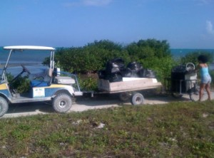 Luciana's golf cart is the garbage truck!