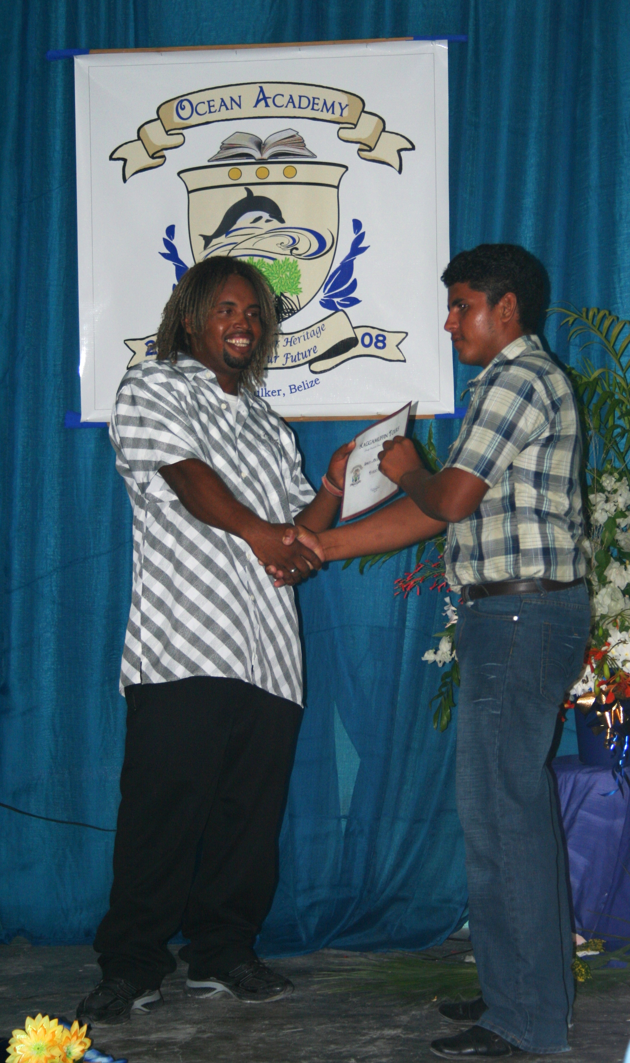 Patrick presenting award to Ocean Academy student