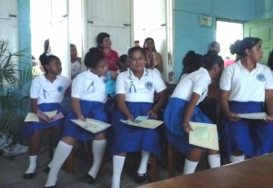 The girls with their certificates of graduation