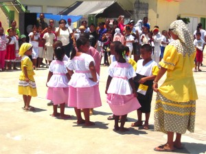 School kids representing the Garifuna culture dancing punta.